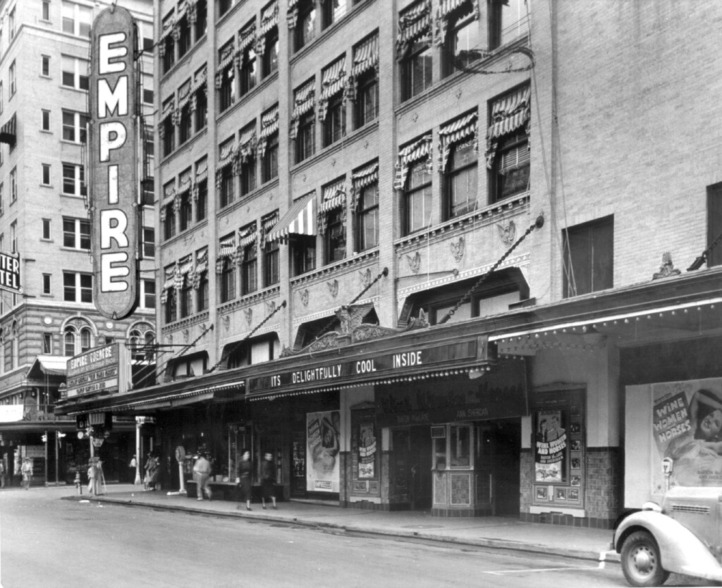 """In 1921, a storm caused the San Antonio River to rise and flood the downtown area. Approximately nine feet of water drained into the theatre's orchestra level and the plasterwork, woodwork and gold-leaf interior were damaged. Rather than repair the damage back to the original design, the entire theatre was painted a monotone white, burying the rich detail that once gleamed.  After being dark for 20 years, Las Casas Foundation restored this crown jewel to """"golden glory"""" in 1998 at an approximate cost of $5.5 million."""