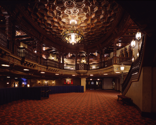 """The """"wood-like"""" ceiling in the Majestic Theatre rotunda is actually made of plaster. The chandelier, an original part of the theatre when it opened on June 14, 1929, is reminiscent of a golden crown with precious gems."""